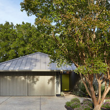 Midcentury Exterior by Flegel's Construction Co., Inc.