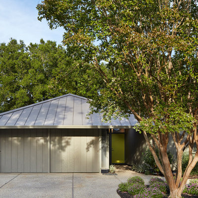 Inspiration for a 1950s one-story exterior home remodel in San Francisco with a hip roof