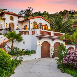 Example of a large tuscan stucco exterior home design in Los Angeles