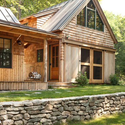 Inspiration for a rustic wood exterior home remodel in Portland Maine with a metal roof