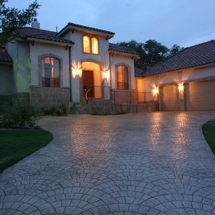 Inspiration for a mid-sized mediterranean two-storey stucco white exterior in Austin with a hip roof.