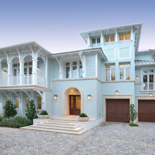 Example Of A Coastal Blue Two Story Exterior Home Design In Miami