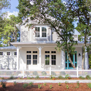 Inspiration for a mid-sized victorian white two-story brick gable roof remodel in Jacksonville