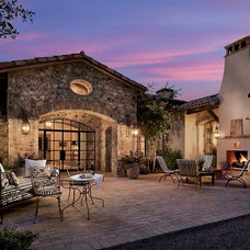 Southwestern Exterior by Calvis Wyant Luxury Homes