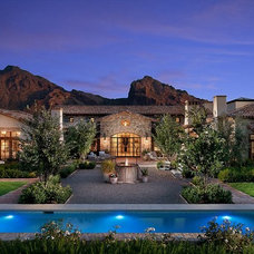 Mediterranean Exterior by Calvis Wyant Luxury Homes