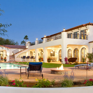 Example of a huge tuscan two-story exterior home design in Phoenix