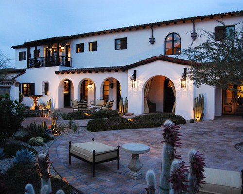 Example Of A Tuscan Two Story Exterior Home Design In Phoenix With A Tile  Roof