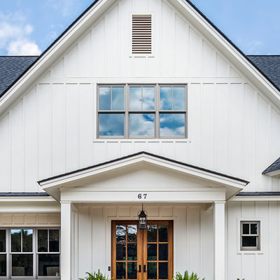 Inspiration for a mid-sized farmhouse white two-story concrete fiberboard exterior home remodel in Other with a shingle roof