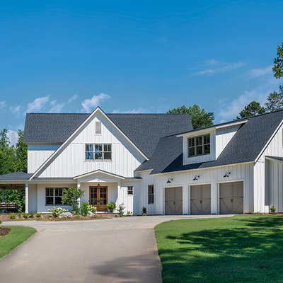 Mid-sized cottage white two-story concrete fiberboard exterior home photo in Other with a shingle roof
