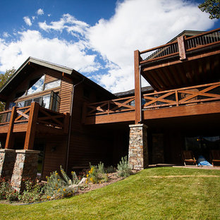 Mid-sized rustic brown two-story wood exterior home idea in Salt Lake City