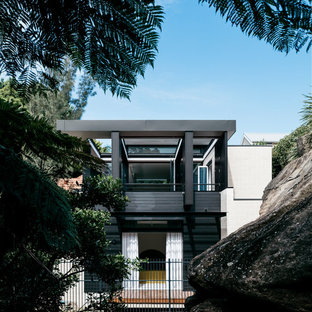Inspiration for a mid-sized contemporary black two-story wood exterior home remodel in Sydney with a metal roof