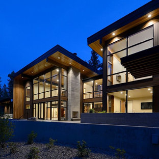Large modern brown two-story wood flat roof idea in Seattle