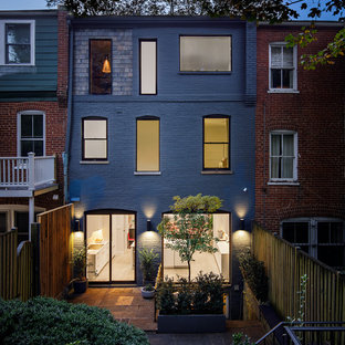 Example of a mid-sized 1960s gray two-story brick townhouse exterior design in DC Metro with a hip roof