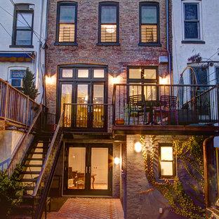 Elegant brick exterior home photo in New York