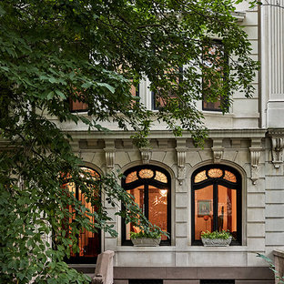 Transitional beige three-story stone townhouse exterior photo in New York