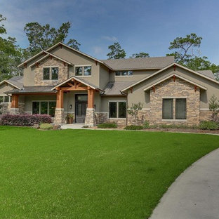 Mid-sized craftsman green two-story stucco exterior home idea in Houston with a shingle roof