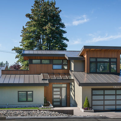 Mid-sized contemporary multicolored two-story mixed siding exterior home idea in Vancouver with a metal roof