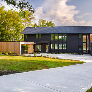 Example of a trendy black two-story mixed siding exterior home design in Charlotte with a metal roof