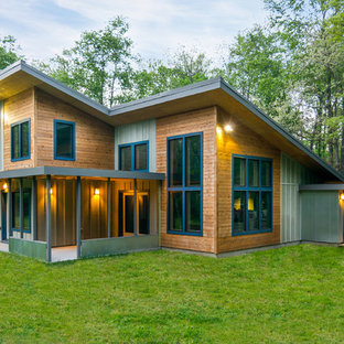 Large contemporary multicolored two-story mixed siding house exterior idea in Detroit with a shed roof