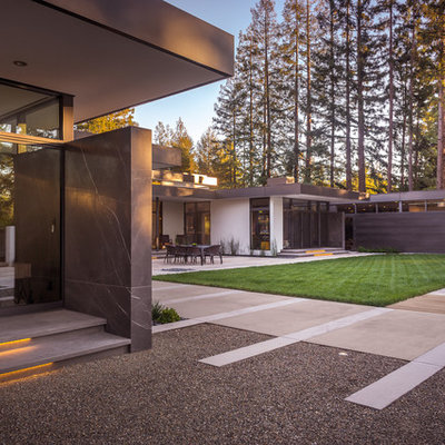 Inspiration for a large contemporary black one-story stone flat roof remodel in San Francisco