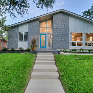 Photo of a gey and medium sized midcentury one floor brick exterior in Dallas with a pitched roof.