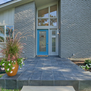 Inspiration for a mid-sized mid-century modern gray one-story brick gable roof remodel in Dallas