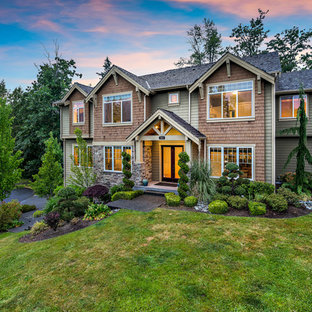 Inspiration for a large timeless green two-story mixed siding gable roof remodel in Seattle with a shingle roof