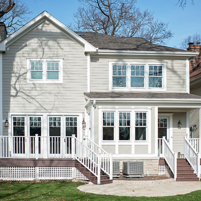 Large elegant gray two-story concrete fiberboard exterior home photo in Chicago with a mixed material roof