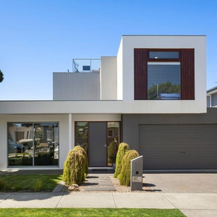 Inspiration for a mid-sized contemporary two-storey multi-coloured house exterior in Geelong with mixed siding, a flat roof and a metal roof.