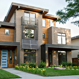 Contemporary brick duplex exterior idea in Denver