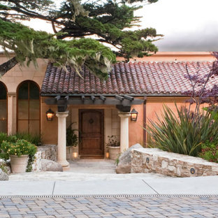 Large tuscan pink one-story exterior home photo in Other