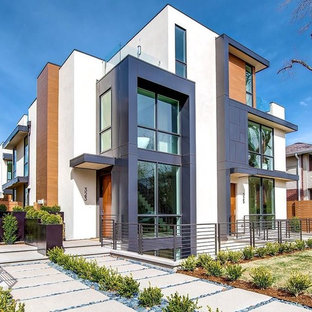 Contemporary multicolored three-story exterior home idea in Other