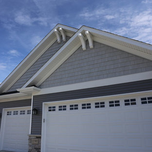 Mid-sized craftsman gray one-story mixed siding gable roof idea in Chicago