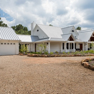 Country white one-story exterior home photo in Houston with a metal roof