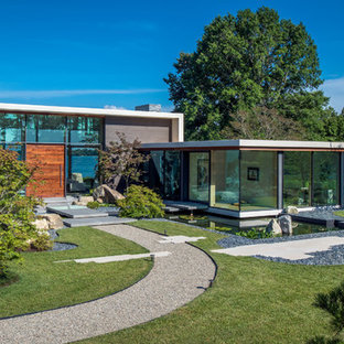 Contemporary one-story glass flat roof idea in Other