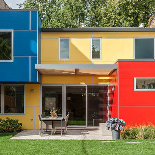 Large contemporary multicolored one-story mixed siding flat roof idea in Chicago
