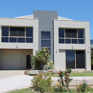 This is an example of a large contemporary two-storey concrete grey house exterior in Perth with a metal roof.