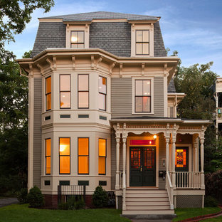 Mid-sized victorian gray three-story wood exterior home idea in Boston with a hip roof