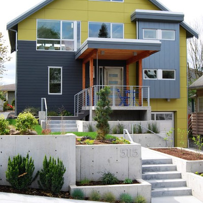 Inspiration for a contemporary green three-story mixed siding exterior home remodel in Seattle