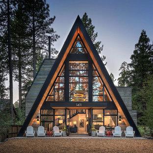 Mountain style glass house exterior photo in Sacramento