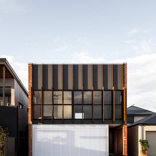 Design ideas for a mid-sized industrial two-storey exterior in Perth.