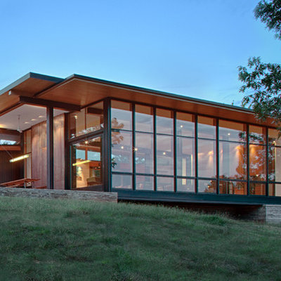 Modern brown mixed siding house exterior idea in Charlotte with a shed roof