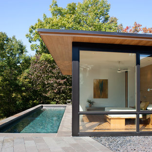 Modern one-story wood house exterior idea in Charlotte with a shed roof