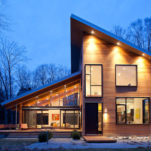 Inspiration for a contemporary exterior in Grand Rapids with wood siding and a shed roof.
