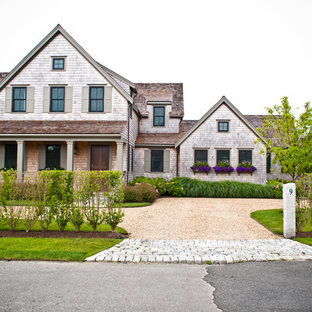 Large traditional two-story wood gable roof idea in Boston