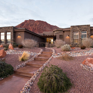 Southwestern brown one-story adobe house exterior idea in Salt Lake City with a hip roof and a shingle roof