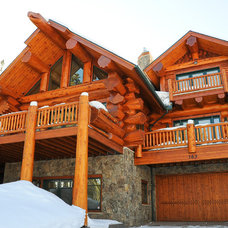 Rustic Exterior by Mountain Log Homes of CO, Inc.
