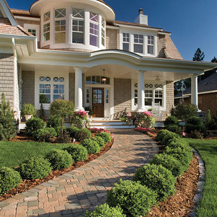 Inspiration for a victorian two-story wood exterior home remodel in St Louis