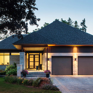 Design ideas for a contemporary one floor exterior in Ottawa with mixed cladding and a hip roof.