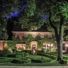 Traditional Exterior by The Landscape Lighting Specialist